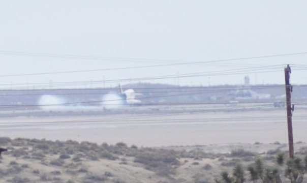 Touchdown - twin dustplumes from gear touching down
